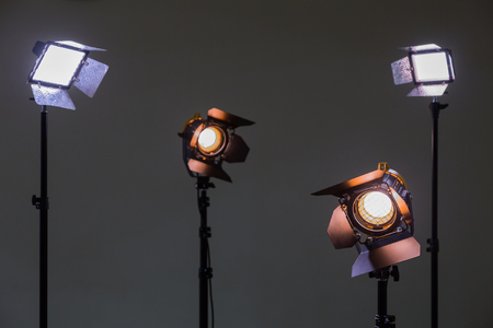 lamp light: Two floodlights with halogen lamps and Fresnel lens and two led lighting device. Shooting in the interior on a gray background.
