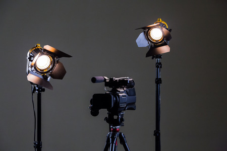 Camcorder and 2 spotlights with Fresnel lenses in the interior. Shooting an interview.
