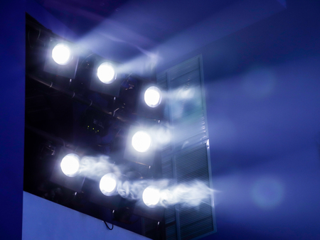 Lighting equipment on the stage. The spotlight through the smoke. Theater performance. Stock Photo - 84416686