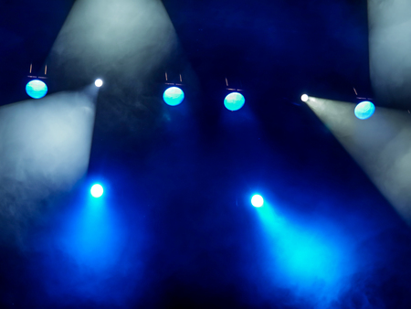 Lighting equipment on the stage. The spotlight through the smoke. Theater performance.