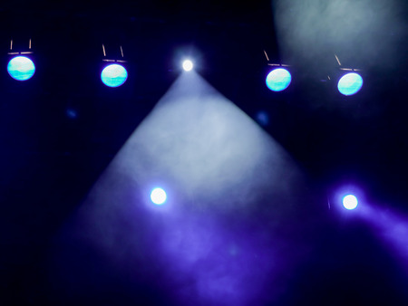 Lighting equipment on the stage. The spotlight through the smoke. Theater performance. Stock Photo - 84416697