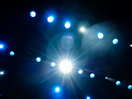 nightspot: Lighting equipment on the stage. The spotlight through the smoke. Theater performance.