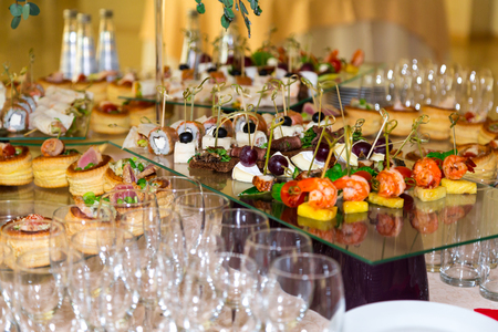 Snacks, fish and meat specialties on the buffet. A gala reception. Served tables. Catering.