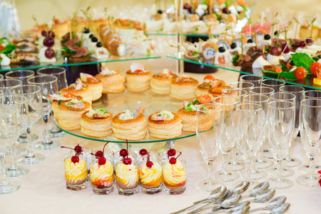 Snacks, fish and meat specialties on the buffet. Desserts. A gala reception. Served tables. Catering. Stock Photo