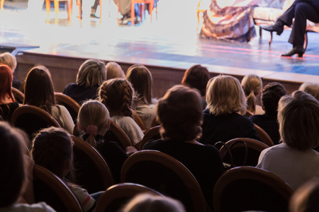 The audience in the theater. The audience in the hall: adults and children. Stock Photo