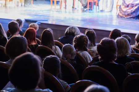 The audience in the theater. The audience in the hall: adults and children. Stock fotó