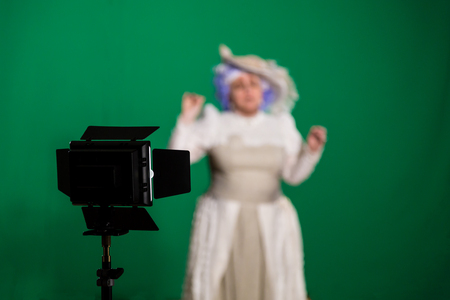 The actress shot on a green background. Lighting equipment in the Studio.