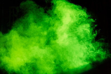 Green theatrical smoke on stage. Stock Photo