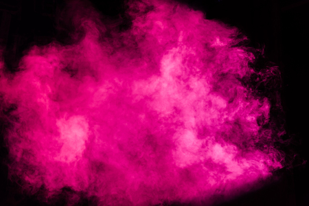 Magenta theatrical smoke on stage during a performance or show.