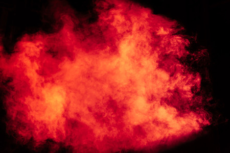 Red and yellow theatrical smoke on stage. Lighting equipment. Stock Photo - 91100958