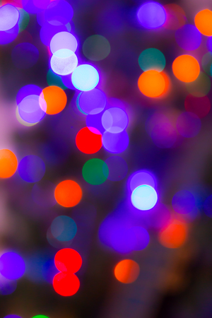 Christmas abstract blurred background. Multi-colored lights. Unfocused image. Christmas tree garland in a blur.