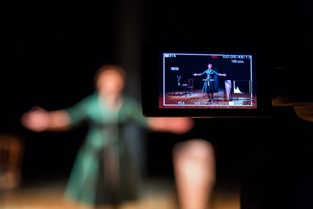 Filming performances of the actress or singer in the interior. A digital video camera. Color lcd display. The TV Studio.