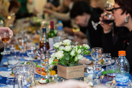 The people at the Banquet. A solemn event in the enterprise. Anniversary or wedding. Snacks and alcohol on the tables. Served buffet style. Catering.