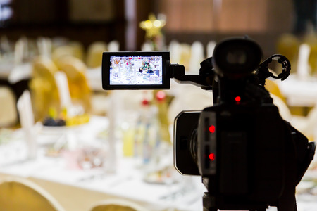 Filming of the event. Videography. Served tables in the Banquet hall. Stock Photo