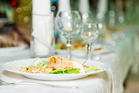 Salad in plate and Cutlery for the Banquet table. A solemn event. Catering. Banco de Imagens