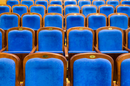 Blue brown wooden chairs in the auditorium. Without people. Stock Photo