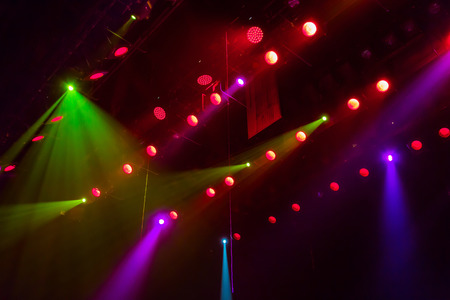Lighting equipment on the stage of a theater or concert hall. The rays of light from spotlights.