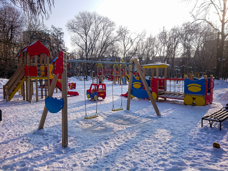 Childrens Playground in the city Park. Sunny winters day.