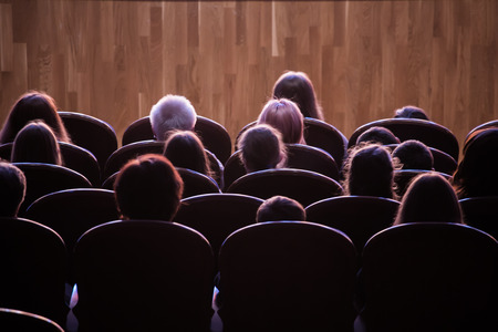 Spectators in the theater or in the cinema. Children and adults. Full house. Stock Photo - 100265727