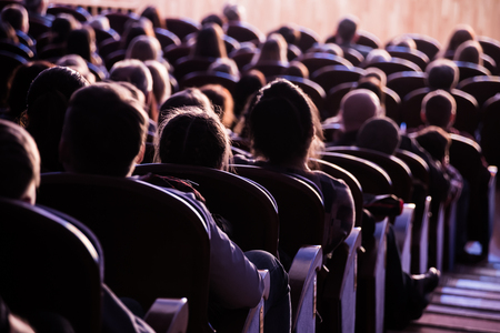 Spectators in the theater or in the cinema. Children and adults. Full house. Stock Photo - 100280028