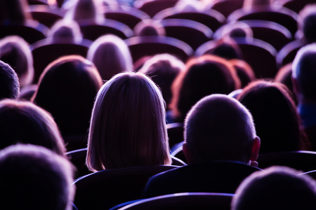 Spectators in the theater or in the cinema. Children and adults. Full house. Stock Photo - 100285903