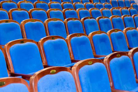 Blue brown wooden chairs in the auditorium. Without people