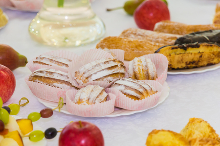 Served tables at the Banquet. Desserts, fruit and pastries on the buffet. Catering. Stock Photo