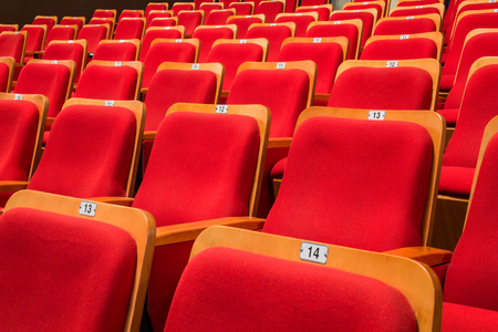 Red chairs in the auditorium