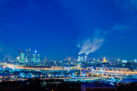 """Moscow international business center """"Moscow-city"""". Night or evening cityscape. Blue sky and street lights. Urban architecture."""