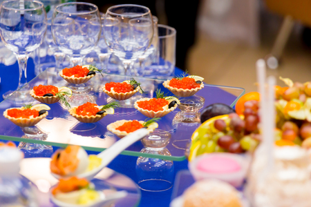 Red caviar on the table. Delicacies and Cutlery at the buffet. Catering
