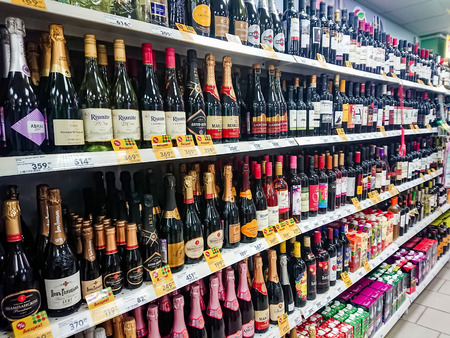 Saratov / Russia - January 2, 2019: Goods on the shelf of a grocery store. Wine and other alcoholic beverages.