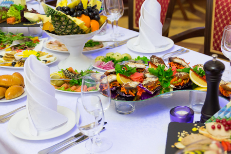 Delicacies, snacks and fruit on the restaurant table. Celebration. Catering Banquet table.