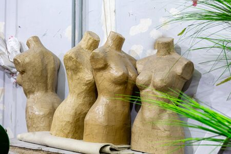 Four female mannequin made of papier mch in the theater art studio.