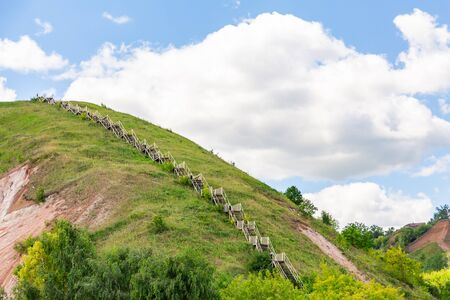 Stairs to the mountain. The hilly Bank of the Volga in Tetyushi, Tatarstan, Russia. Sunny summer day. White clouds in a blue sky.