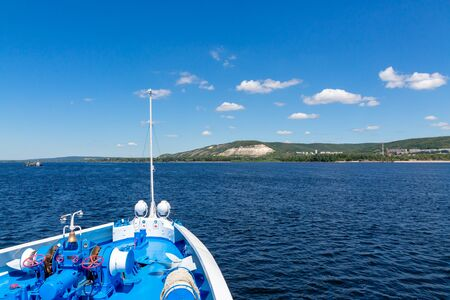 Zhiguli mountains in the Samara region. Volga River, Russia. Shooting from a river cruise ship. Summer sunny day. Picturesque landscape. Stok Fotoğraf - 131890539
