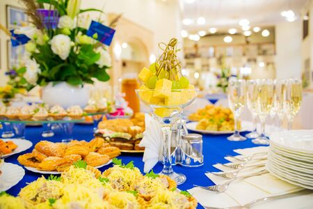 Grape and cheese canap?s. Festively laid tables at the Banquet. Various delicacies, snacks and drinks. Catering.