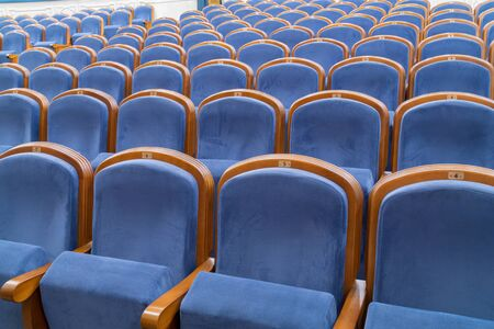 Blue plush chairs in the auditorium of the theater. The interiors of the concert hall. Stok Fotoğraf - 132328410