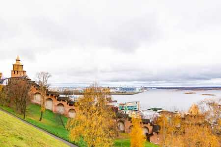 View of the Volga river and the Oka river from the embankment of Nizhny Novgorod. The walls of the stone Kremlin. Autumn cloudy day.