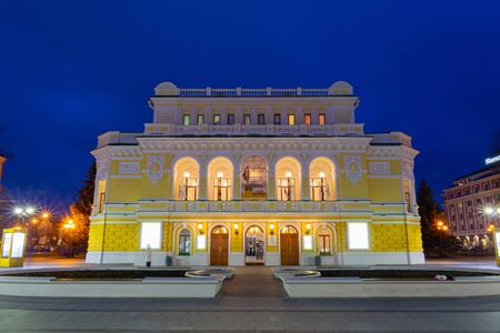 Nizhny Novgorod / Russia - October 16, 2019: Nizhny Novgorod drama theater named after Maxim Gorky. Evening cityscape. City lights. Long exposure.
