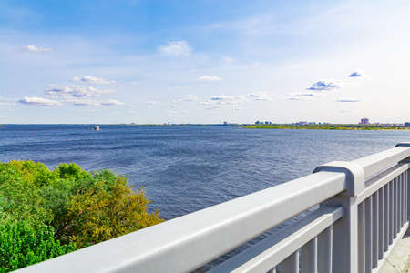 River landscape. Shooting from a road bridge over the Volga River between the cities of Saratov and Engels, Russia. A sunny September day. The ship is on the horizon