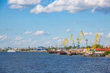 Cargo river port on the Volga River in the city of Kazan. Republic of Tatarstan, Russia. Ships at the docks. A sunny summer day.