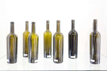purified: Empty bottles of wine on a white background aligned Stock Photo