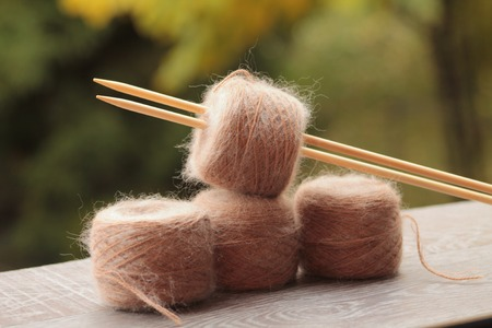 mohair: Balls of Alpaca and Mohair green background