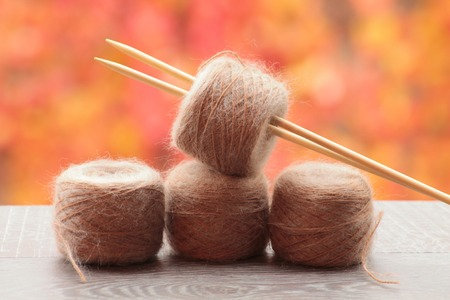 tricot: Balls of alpaca and mohair orange background
