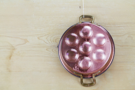 oxidized: old copper pot for eggs half polished half oxidized Stock Photo