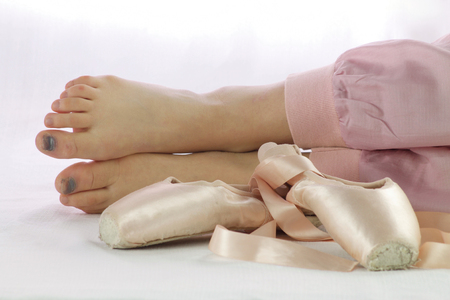 girl shoes: ballerina feet tired to work with pointe shoes Stock Photo