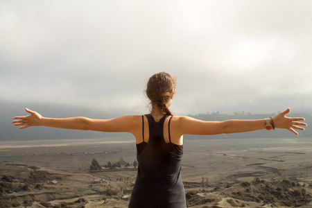 embraced: young girl embraced the beauty of nature , sand sea at Mount Bromo