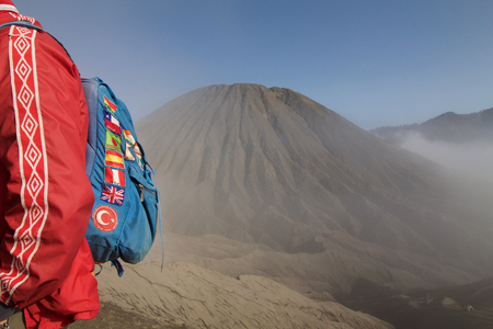 trotter: globe trotter backpacker near batok volcano, Java island