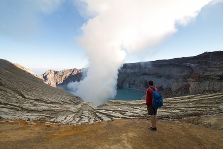 Hiker looking at the crater of Kawah Ijen, Indonesia
