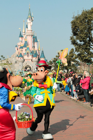 DISNEYLAND PARIS - MARCH 11, 2016 :some characters of walt disney in the spring Parade, Goofy and Clarabella